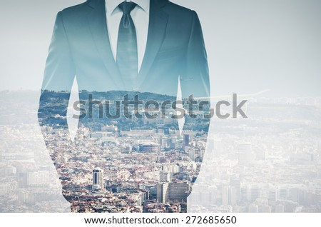 double exposure of young businessman in black suit - stock photo