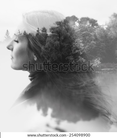 double exposure of young female and the forest near the lake(tilt-shift lens) - stock photo