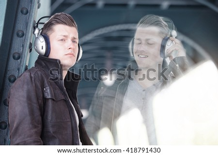 double exposure of young man with headphones listening to music - stock photo
