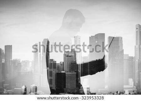 Double exposure of young man with laptop on the background - stock photo