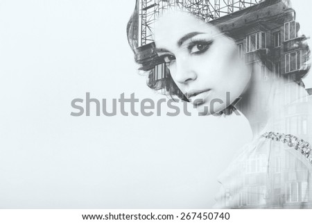 Double exposure of young woman and metropolis. Creative black and white portrait - stock photo