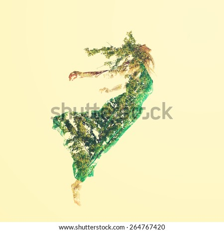 Double exposure of young woman flying with abstract leaves - stock photo