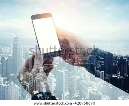 Double exposure photo modern smartphone holding male hands. Panoramic view contemporary city and clouds background. White blank screen ready for your business information.Horizontal mockup - stock photo