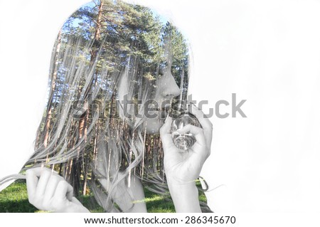 Double exposure photo of a teenage girl smelling perfume and evergreen forest - stock photo