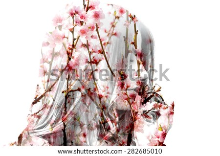 Double exposure photo of flowering branches and girl smelling perfume - stock photo