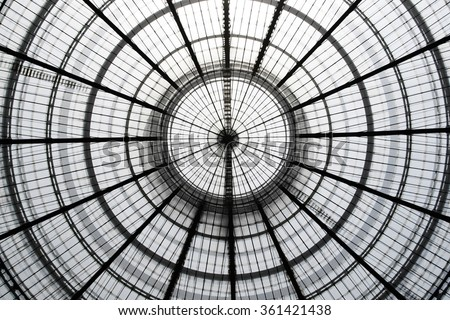 Double exposure photo of transparent circular glass ceiling / roof at two different zooms. Realistic but not real architectural image with doubled number of circles compared to the real object. - stock photo