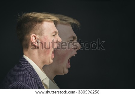 Double Exposure photo. Portrait of an man in a business suit on a black background. Side profile portrait of angry man screaming  - stock photo