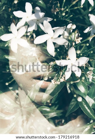Double exposure photograph of beautiful woman and flowers - stock photo