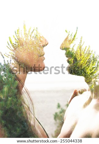 Double exposure portrait of a couple combined with photograph of greenery - stock photo