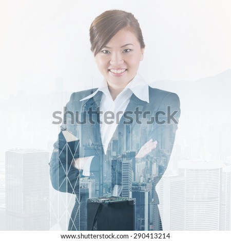 Double exposure portrait of a happy Asian business woman standing with city of Hong Kong in background.
