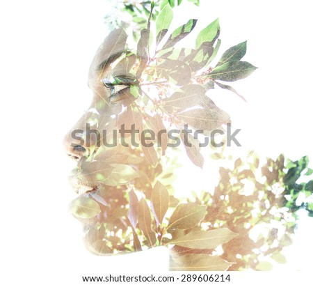 Double exposure portrait of attractive woman combined with photograph of nature - stock photo