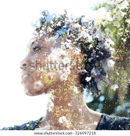 Double exposure portrait of attractive woman combined with photograph of tree - stock photo