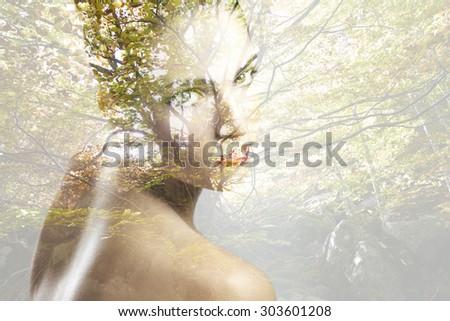 Double exposure portrait of beautiful caucasian woman. - stock photo