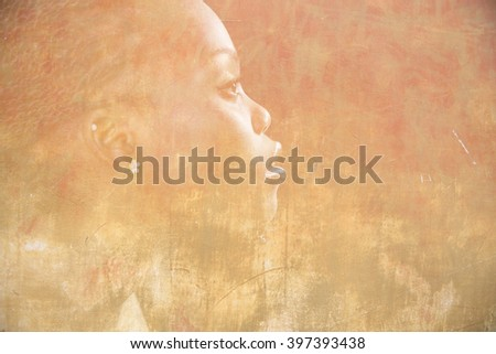 Double exposure portrait of beautiful woman. Beauty portrait of young african woman in profile with obsolete grunge wall background - stock photo