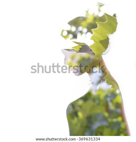 Double exposure portrait of beautiful woman. Beauty portrait of young mulatto woman in profile with summer tree over white.