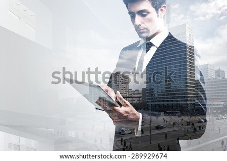 Double exposure portrait of young Businessman Using Digital Tablet