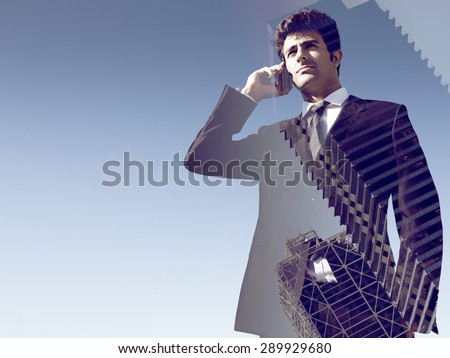 Double exposure portrait of young Businessman Using mobile