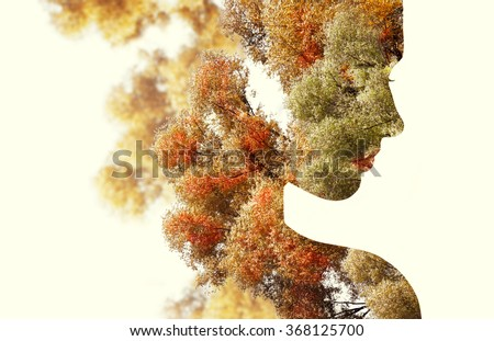 Double exposure portrait of young woman and autumn trees.