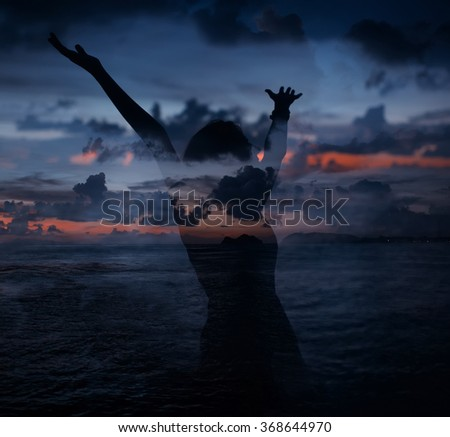 Double exposure portrait of  young woman silhouette combined with image of the sea and evening sky