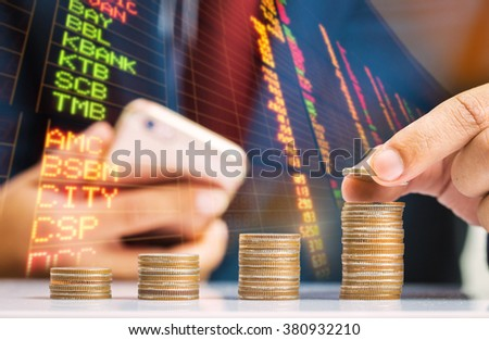 Double exposure,Saving money concept,Investment,Business man hand putting money coin stack growing business - stock photo