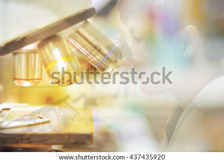 double exposure Scientist using  microscope in a laboratory - stock photo