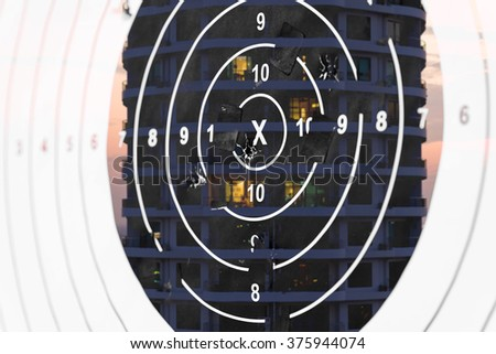 Double exposure. Shooting target at the building.Illustration of a  target by a sniper - stock photo