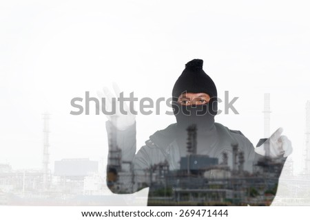 double exposure thief in the city - stock photo
