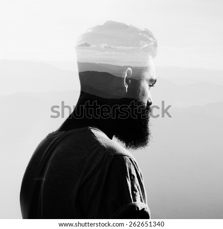 Double exposure with bearded man and mountains - stock photo