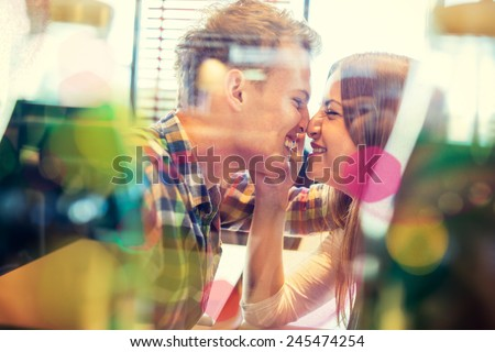 Double exposure with lovely romantic young couple enjoying and having fun in restaurant - stock photo