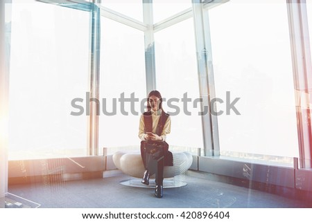 Double exposure with young Japanese woman is chatting on-line via mobile phone, while is sitting in luxury loft interior with modern design. Asian female manager using cell phone for checking e-mail