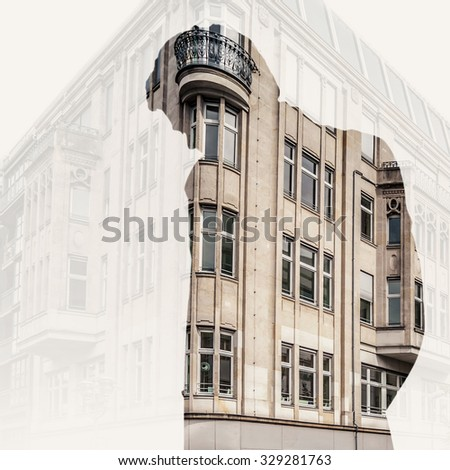Double exposure with young man and old building
