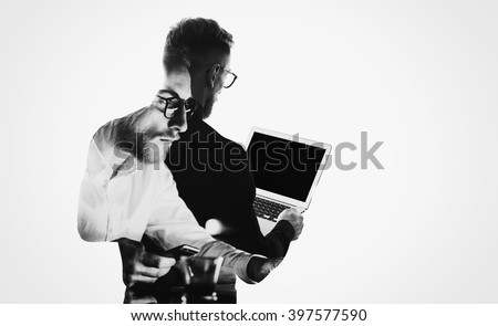 Double exposure young bearded  banker wearing black shirt and holding contemporary notebook hands.Blank screen ready for you message.Isolated white,portrait man background.Horizontal mockup  - stock photo
