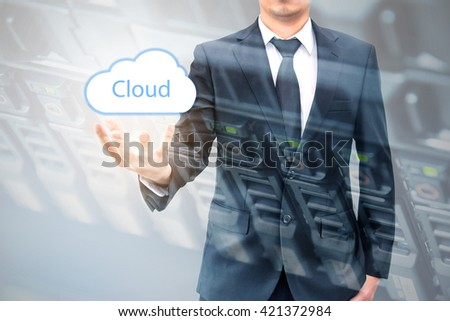 Double expoure of cloud computing concept on hand of a businessman with servers computing technology in datacenter creative cloud concept - stock photo