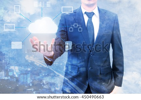 Double expoure of professional businessman connecting cloud technology on hand with cloud and sky in Technology, Communication and business concept