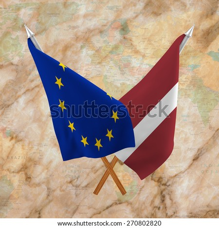 Double flags, partnership of Latvia and European Union on background of Political Map of the World isolated - stock photo