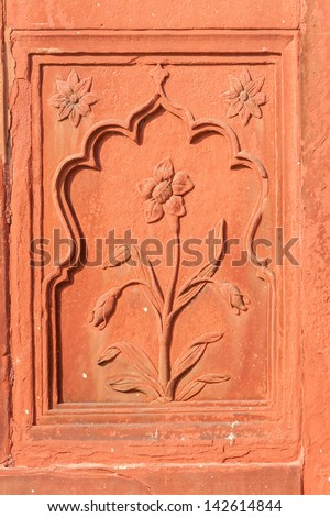 Double framed flower carved in red sandstone at Red Fort's Drum House in Delhi. - stock photo