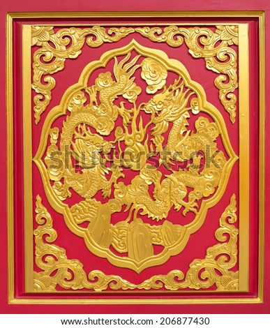 Double golden dragon in chinese style On red wood - stock photo