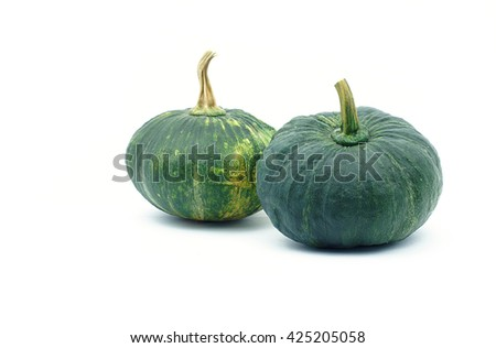 Double green pumpkin on white background. Object side view.