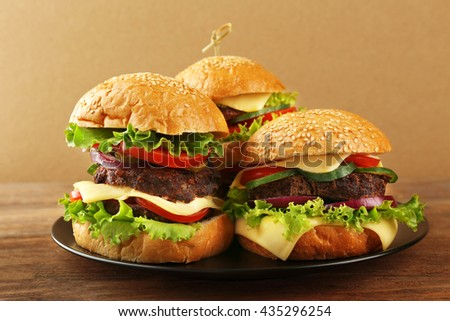 Double hamburgers on wooden table