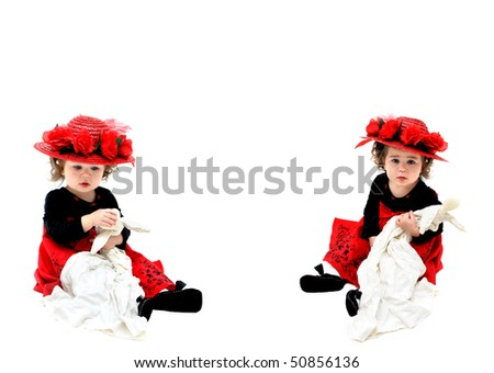 Double image of little girl playing with her old fashioned rag doll and wearing an old fashioned red, straw hat.  She is sitting in an all white room and playing with her doll. - stock photo