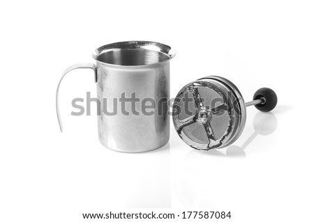 Double mesh milk frother.