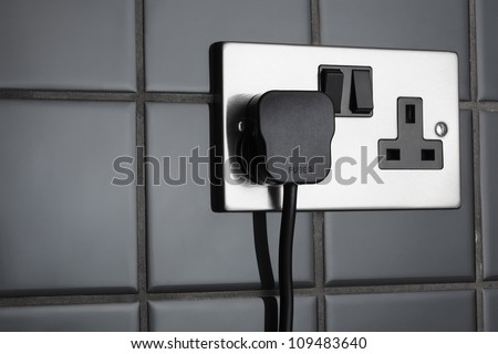 Double plug socket in contemporary kitchen - stock photo