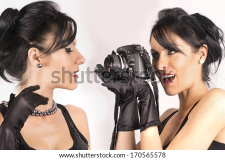double portrait beautiful girls with camera - stock photo