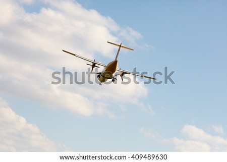Double propeller commercial passenger airplane - stock photo