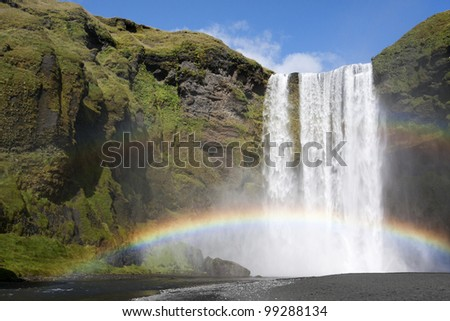 Double rainbow at the waterfall Skogafoss in Iceland - stock photo