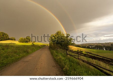 Double rainbow in northern Polands Fields  - stock photo