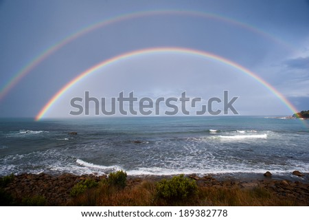 Double Rainbow over the ocean in Australia. The great ocean road - stock photo