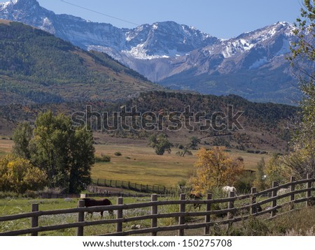 Double RL Ranch in autumn with a view of the Dallas Divide on the back. - stock photo