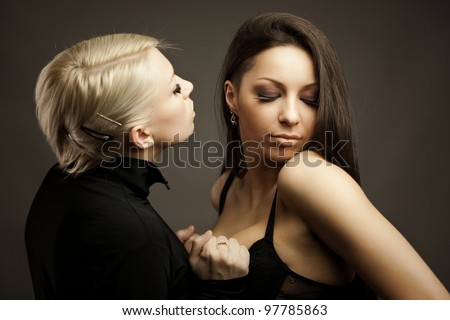 Double sensual portrait of blond and brunette