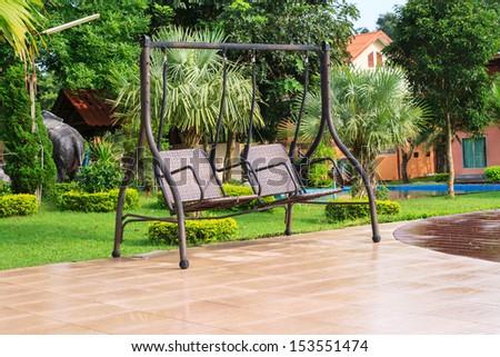 Double swing in the garden  - stock photo